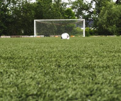 soccer-ball-in-field-with-net