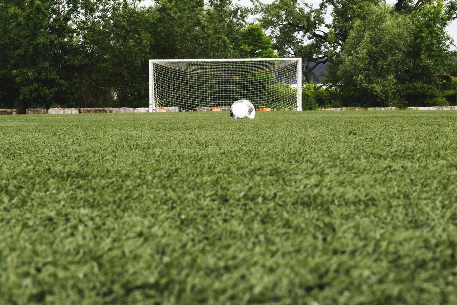 soccer-ball-in-field-with-net
